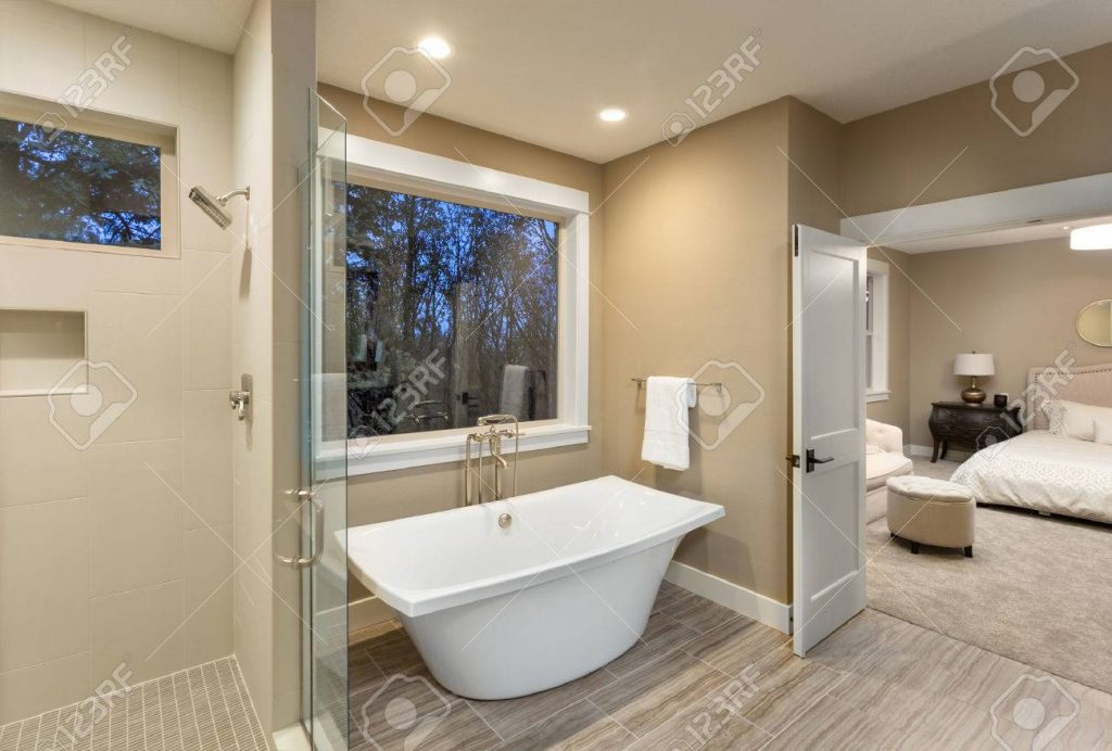 Beautiful Master Bathroom With Bathtub And Shower In New Luxury