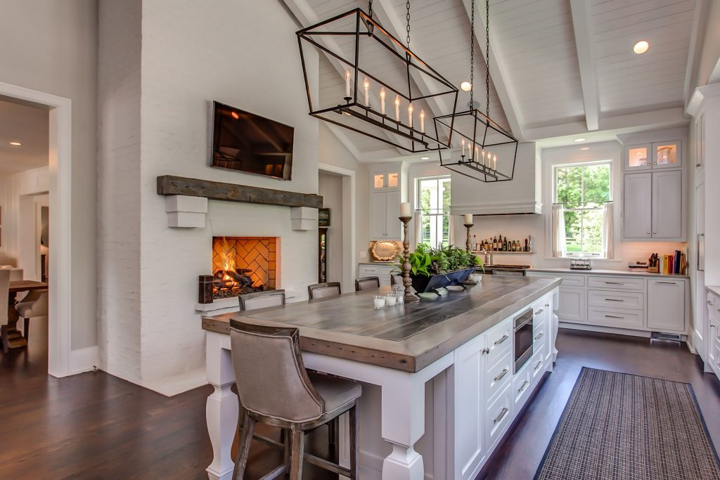 Charming Farmhouse Double Height White Kitchen With Fireplace