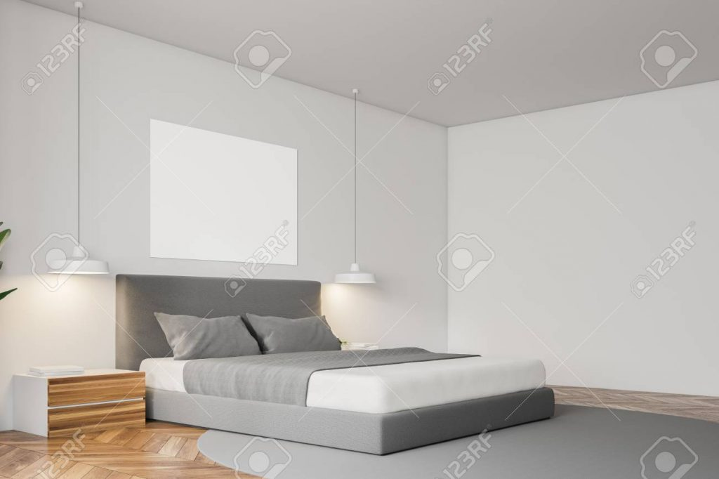 Corner Of White Wall Minimalistic Bedroom With A Wooden Floor