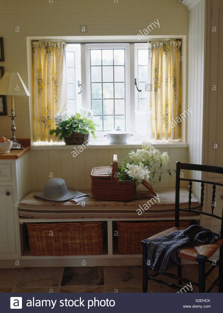Cream Curtains On Window Above Window Seat With Fitted Storage