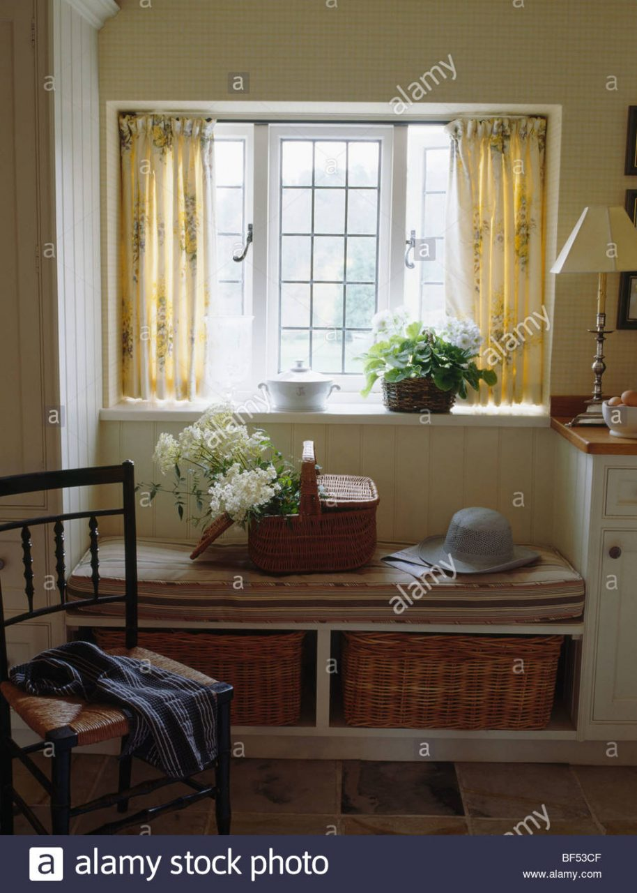 Cream Curtains On Window Above Window Seat With Fitted Storage Stock