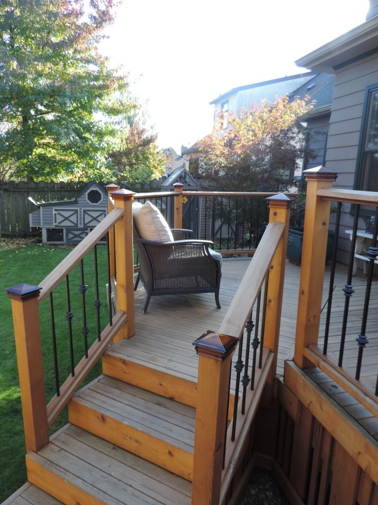 Deck Steps With Wrought Iron Railings And Amber Glass Cap Posts