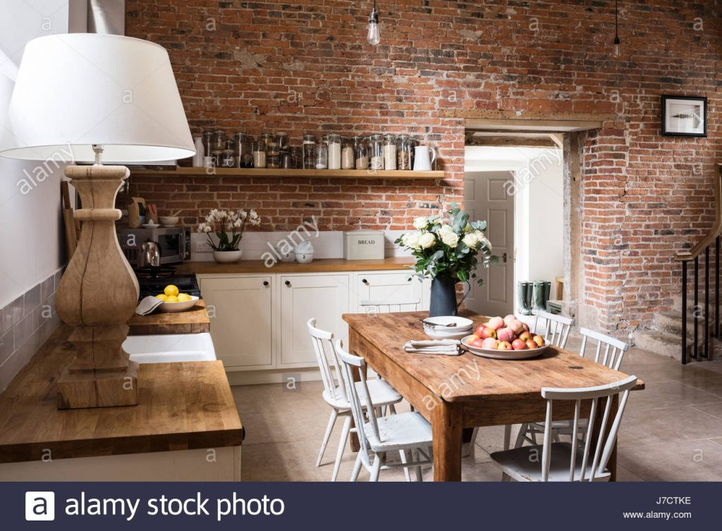 Exposed Brick Wall In Contemporary Feeling Kitchen With Farmhouse