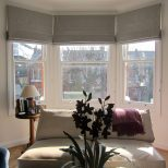 Geometric Patterned Roman Blinds In A Bay Window Could Work In The