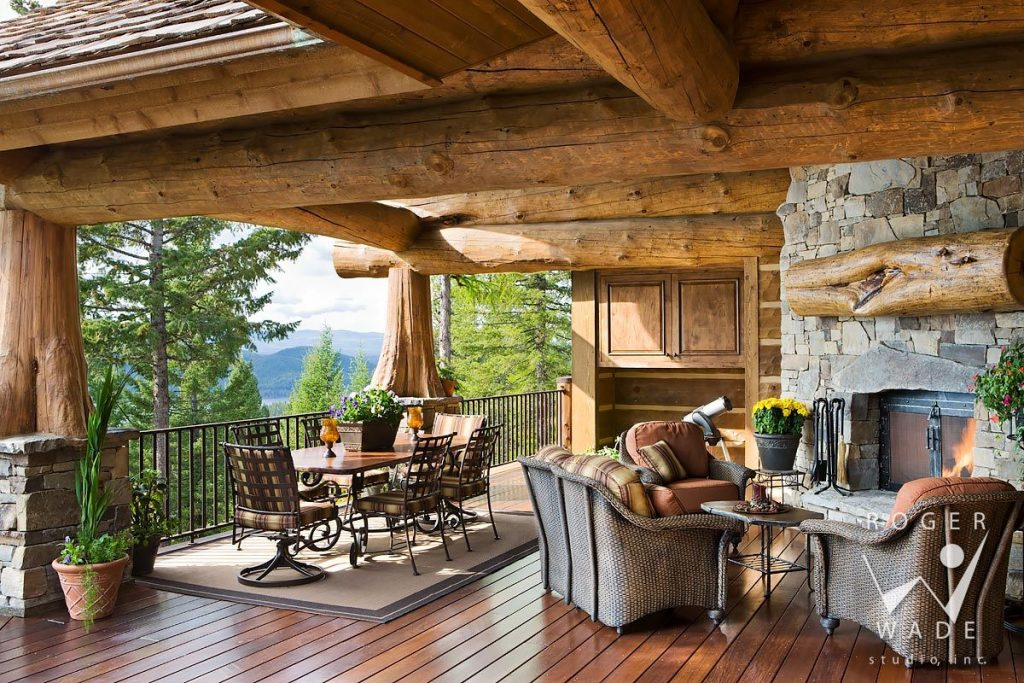 Log Cabin Stock Photo Rear Covered Deck With Fireplace Looking Out