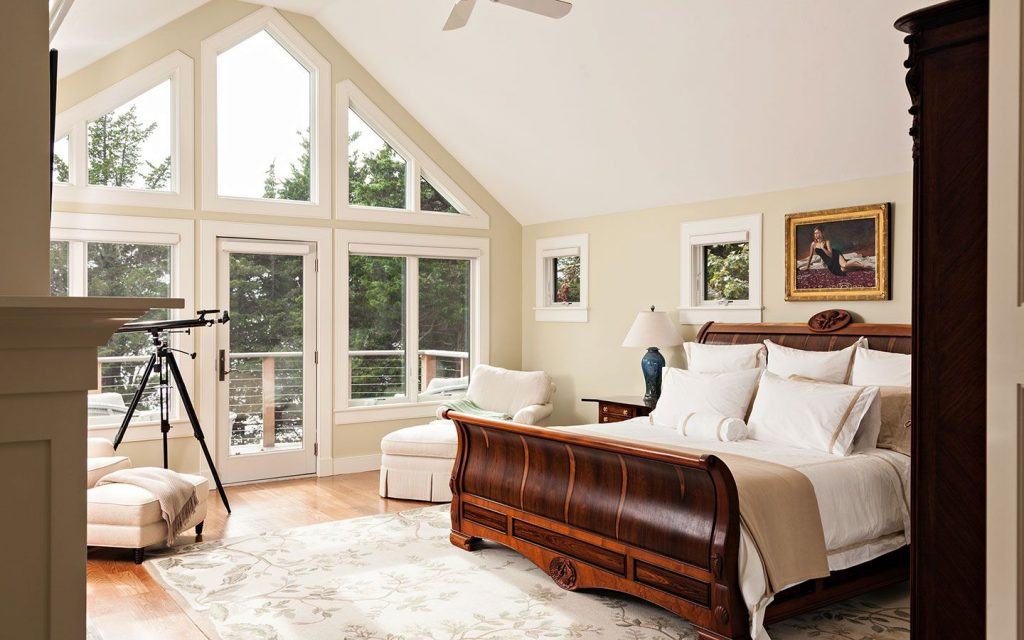 Neutral Colored Cape Cod Bedroom With Hardwood Floors Vaulted