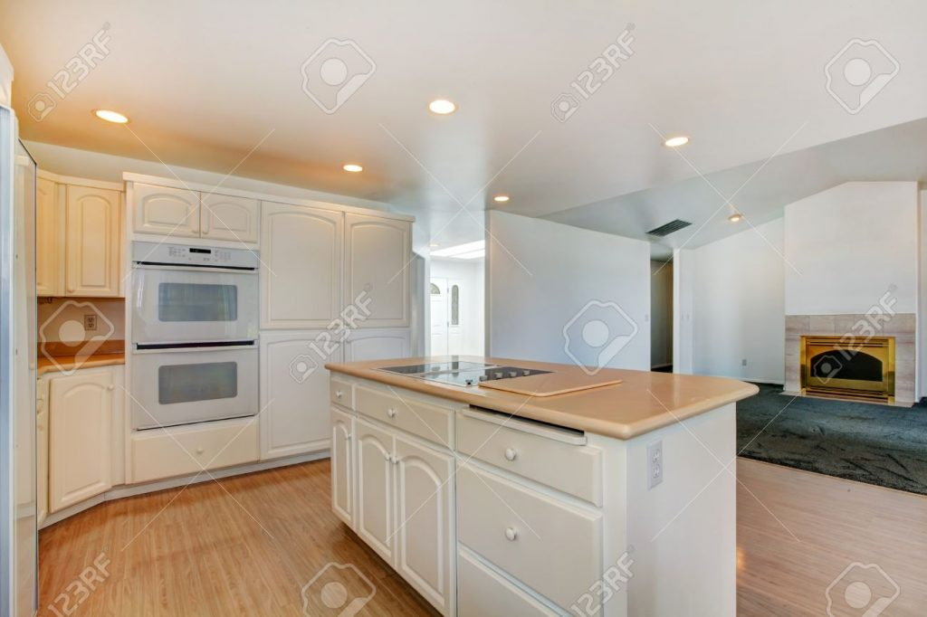 Open Floor Plan White Kitchen Room With Island View Of Empty