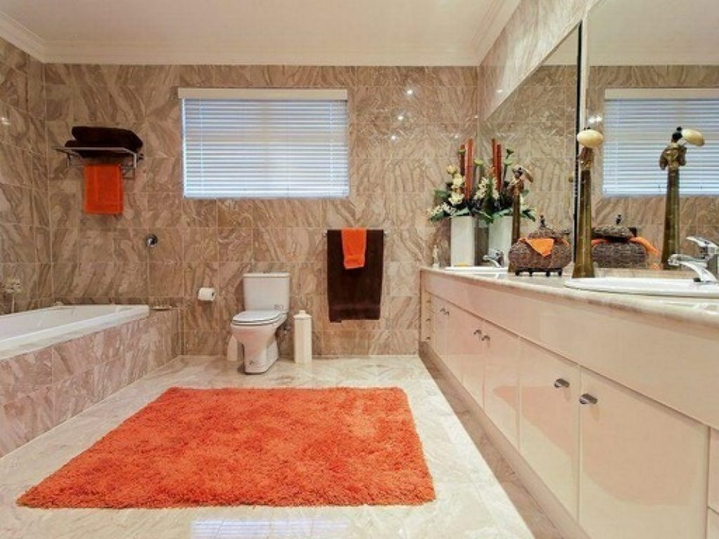 Orange Bathroom Decoration Using Light Brown Marble Bathroom Walls