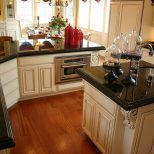 Polished Cream Kitchen Cabinets Black Granite Countertops Cream