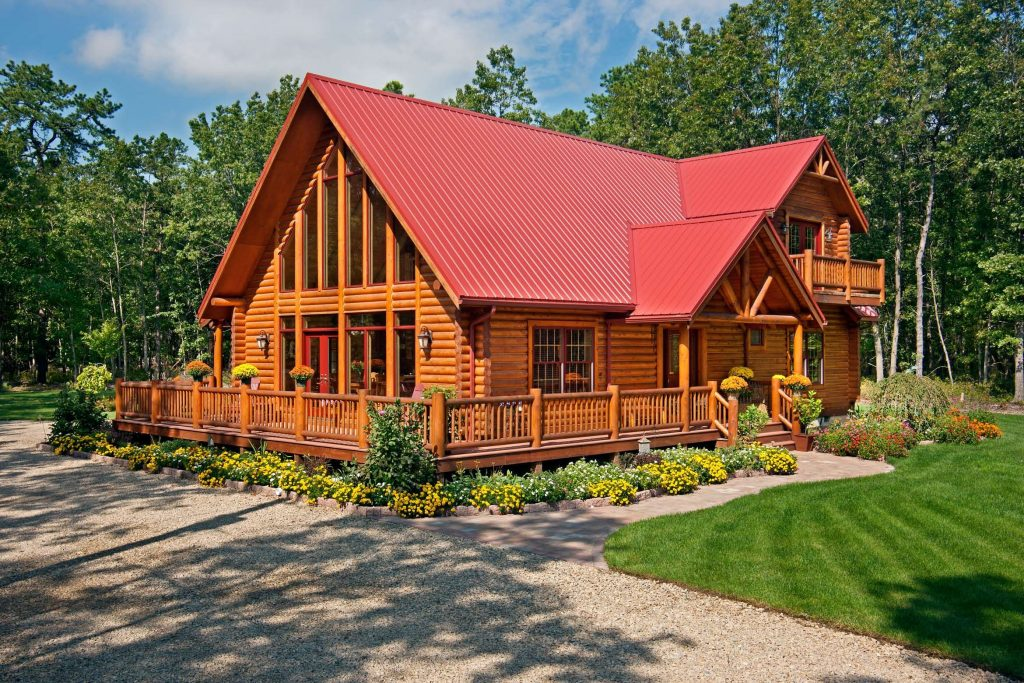 This Log Home Features A Red Metal Roof And A Wraparound Deck Www