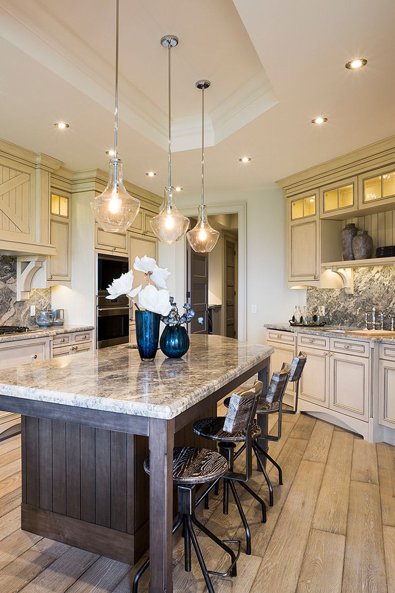 Upscale French Country Elegance With A Stone Topped Island Sleek