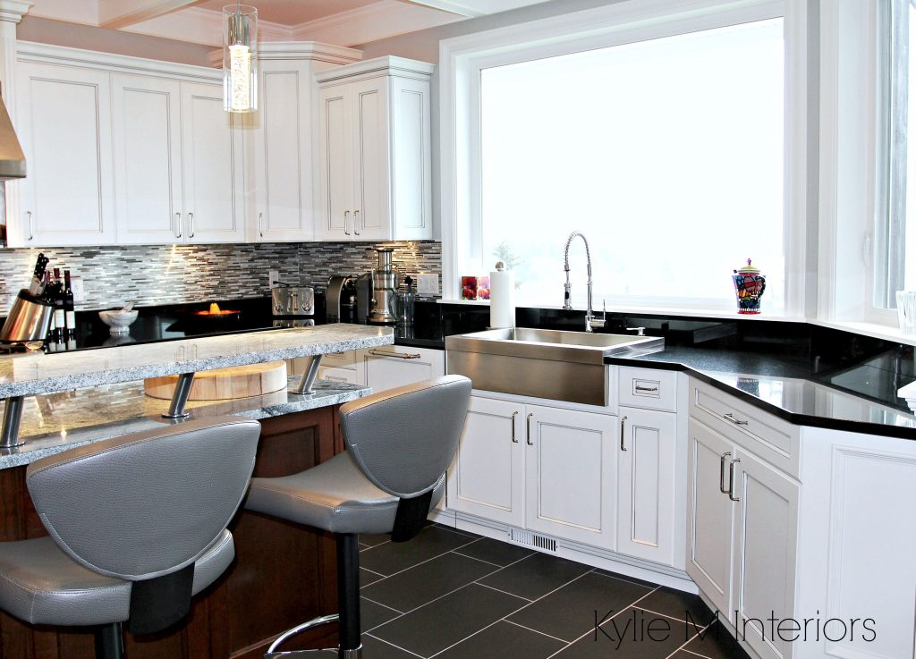 White And Gray Marble Island With Black Granite Countertops White